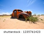 wrecked cars lie abandoned in... | Shutterstock . vector #1235761423
