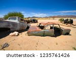 wrecked cars lie abandoned in... | Shutterstock . vector #1235761426