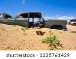wrecked cars lie abandoned in... | Shutterstock . vector #1235761429