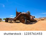 wrecked cars lie abandoned in... | Shutterstock . vector #1235761453