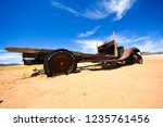 wrecked cars lie abandoned in... | Shutterstock . vector #1235761456