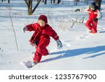 two smiling boys in winter... | Shutterstock . vector #1235767900