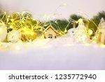 christmas snow in bright lights ... | Shutterstock . vector #1235772940