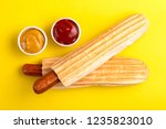 two grilled french hot dogs... | Shutterstock . vector #1235823010