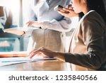 asian business adviser meeting... | Shutterstock . vector #1235840566