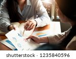 business people analyzing... | Shutterstock . vector #1235840596