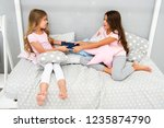greedy kids concept. sisters... | Shutterstock . vector #1235874790