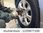 replacing summer tires for...   Shutterstock . vector #1235877100