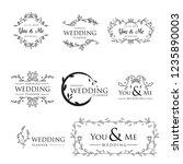 feminine floral wedding logo... | Shutterstock .eps vector #1235890003