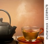 teapot and a cup of tea on an...   Shutterstock . vector #123589678