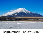 mt fuji  in the early morning.... | Shutterstock . vector #1235910889