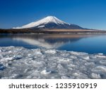 mt fuji  in the early morning.... | Shutterstock . vector #1235910919
