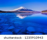 mt fuji  in the early morning.... | Shutterstock . vector #1235910943