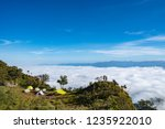 camping in a hug of hill with... | Shutterstock . vector #1235922010