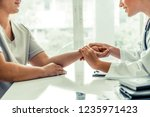 woman doctor talks to female...   Shutterstock . vector #1235971423
