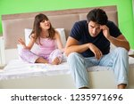 woman and man in the bedroom... | Shutterstock . vector #1235971696