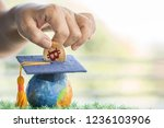 student hand dropping investing ... | Shutterstock . vector #1236103906