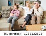 sad worried parents in casual... | Shutterstock . vector #1236132823