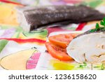 cod with tomato seasoned with... | Shutterstock . vector #1236158620