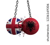 United Kingdom and Albania flag political balls smash into each other. 3D Rendering