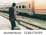 traveler with baggage and map... | Shutterstock . vector #1236176359