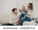happy family playing with a... | Shutterstock . vector #1236287413