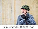 active senior man standing... | Shutterstock . vector #1236301363