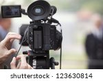 covering an event with a video... | Shutterstock . vector #123630814