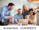 coworkers working together in... | Shutterstock . vector #1236348319