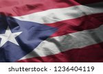 puerto rico flag rumpled close... | Shutterstock . vector #1236404119