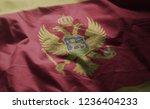 montenegro flag rumpled close...   Shutterstock . vector #1236404233