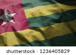 togo flag rumpled close up  | Shutterstock . vector #1236405829