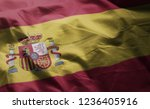 spain flag rumpled close up  | Shutterstock . vector #1236405916