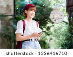 young beautiful female traveler ... | Shutterstock . vector #1236416710