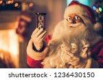 happy santa claus in eyeglasses ... | Shutterstock . vector #1236430150
