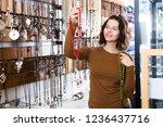 young girl seller offering... | Shutterstock . vector #1236437716