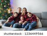 happy family portrait on... | Shutterstock . vector #1236449566