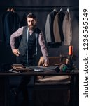 Small photo of Tailor at work. retro and modern tailoring workshop. sewing mechanization. business dress code. Handmade. Bearded man tailor sewing jacket. suit store and fashion showroom. Talented tailor.
