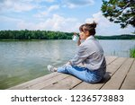 young adult woman sitting on... | Shutterstock . vector #1236573883