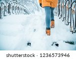 woman walking by snowed city... | Shutterstock . vector #1236573946