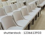 White Chairs Arranged In A...