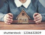 woman hand house model | Shutterstock . vector #1236632839