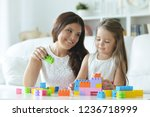 portrait of little girl playing ...   Shutterstock . vector #1236718999