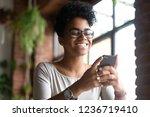 smiling happy african american... | Shutterstock . vector #1236719410