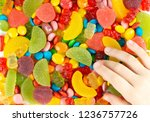 child's hand reaches for the... | Shutterstock . vector #1236757726