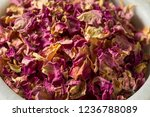 Stock photo raw dry organic rose petals in a bowl 1236788089