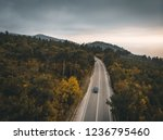 aerial view of car on autumn... | Shutterstock . vector #1236795460