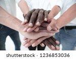 business team joining hands...   Shutterstock . vector #1236853036