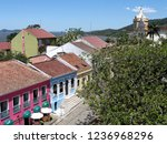 Small photo of Antonina, Brazil - October 28, 2016: Panoramic view of the historic city Antonina with the colorful facades of the colonial mansions and high up is part of the bay and the city's cathedral.