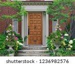 elegant wooden front door... | Shutterstock . vector #1236982576